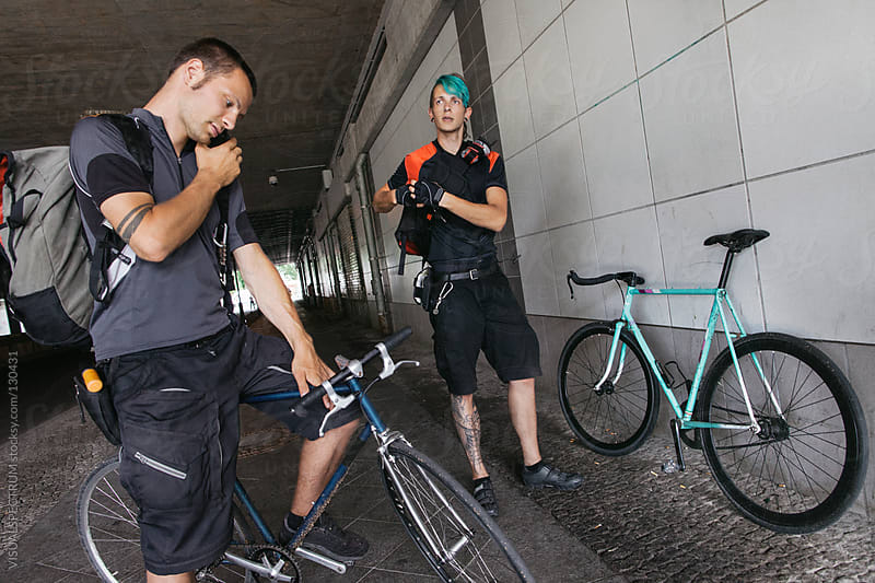 Two Bicycle Messengers Getting Ready For Work by VISUALSPECTRUM for Stocksy United