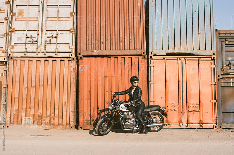 Woman on a motorbike by Branislav Jovanović for Stocksy United