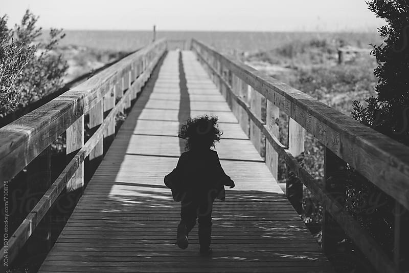 Boardwalk that leads to the beach by ZOA PHOTO for Stocksy United