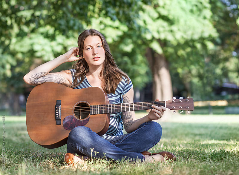 Pretty Young Woman With Guitar by Julien L. Balmer for Stocksy United