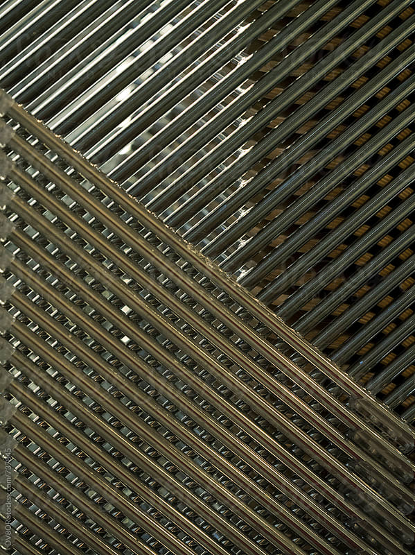 Closeup metal pattern texture created by stacked chairs by DV8OR for Stocksy United