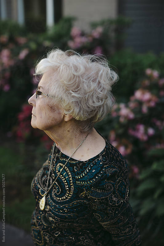 Thoughtful profile of senior caucasian woman outside by Rob and Julia Campbell for Stocksy United