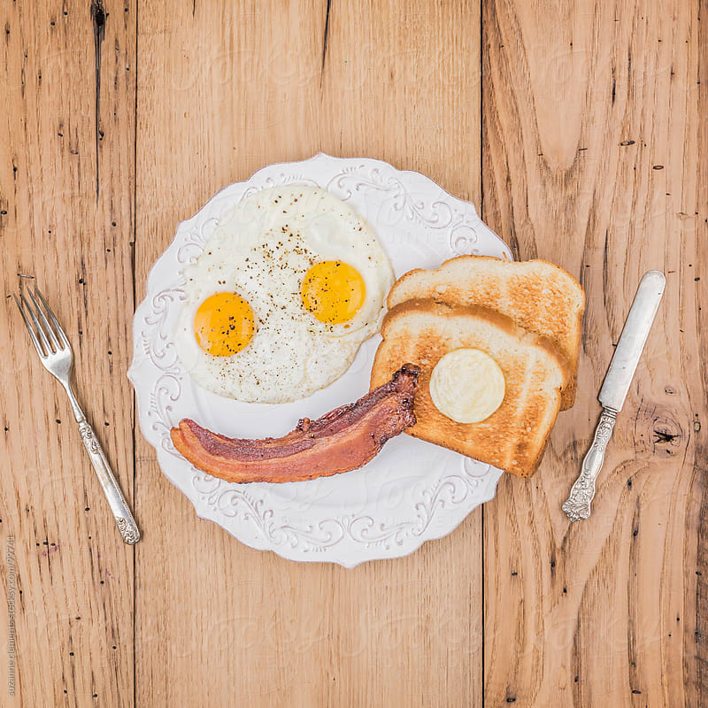 Smiling Eggs and Bacon Breakfast by suzanne clements for Stocksy United