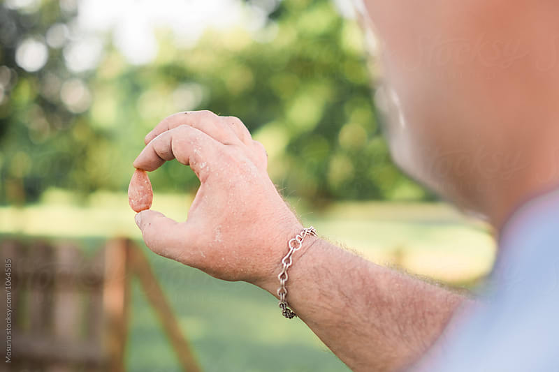 Man Holding a Gemstone  by Mosuno for Stocksy United