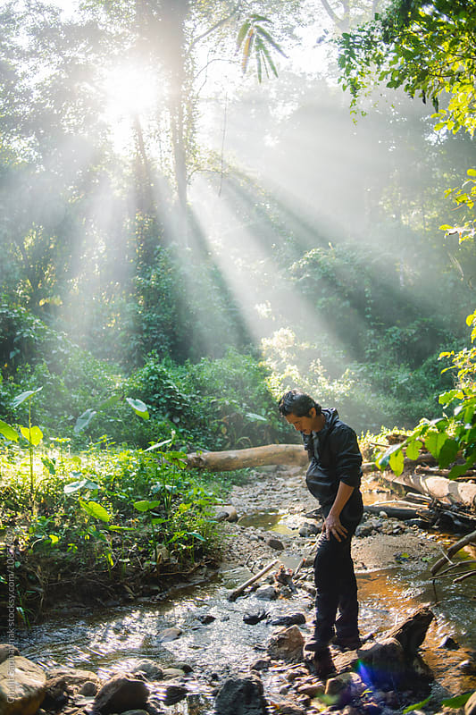 Early morning a man walking in the forest by Chalit Saphaphak for Stocksy United