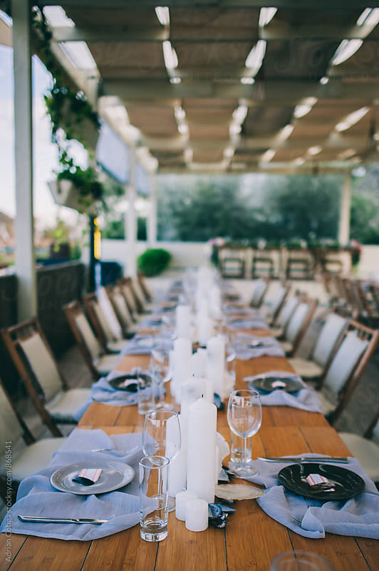 Table set for an event party or wedding reception by Adrian Cotiga for Stocksy United