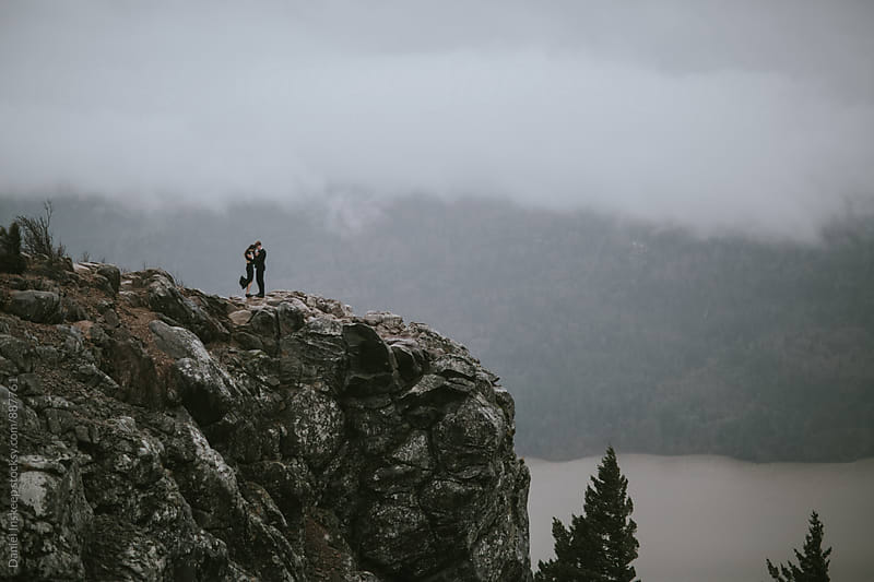 A Couple Standing on a Cliff in the Pacific Northwest by Daniel Inskeep for Stocksy United