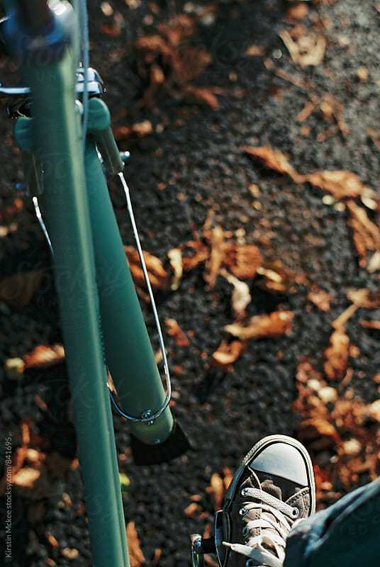Bicycle and fall leaves by Kirstin Mckee for Stocksy United