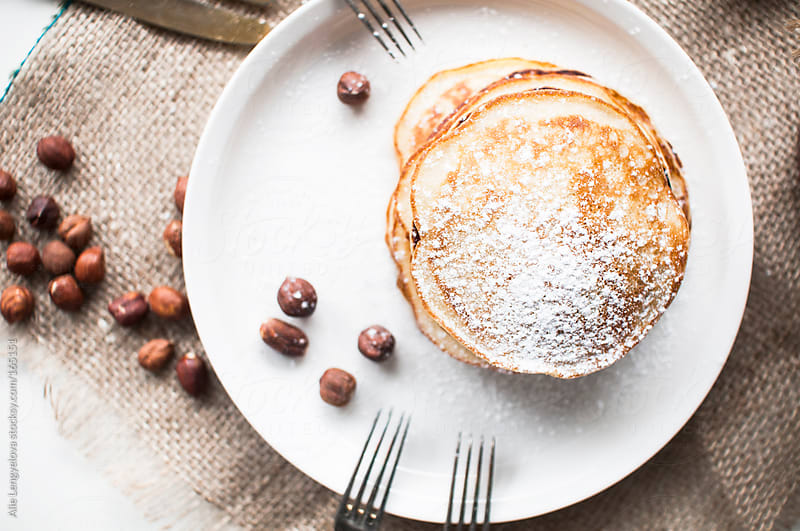 Delicious Homemade Pancakes with Cinnamon by Alie Lengyelova for Stocksy United