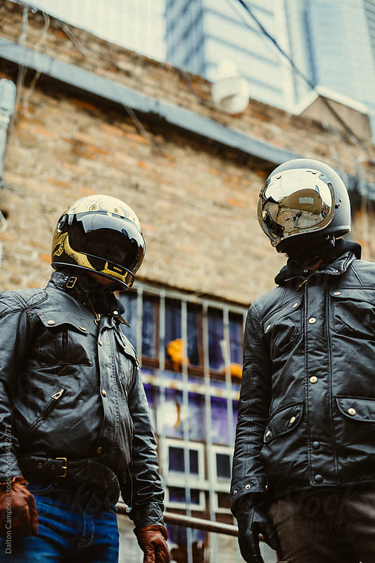 Faceless motorcycle riders around town by Dalton Campbell for Stocksy United