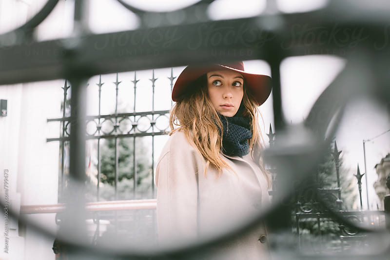 portrait of the young woman with hat outside by Alexey Kuzma for Stocksy United