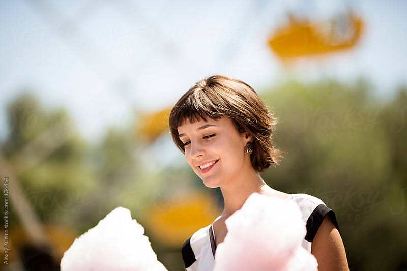 young woman with cotton candy by Alexey Kuzma for Stocksy United