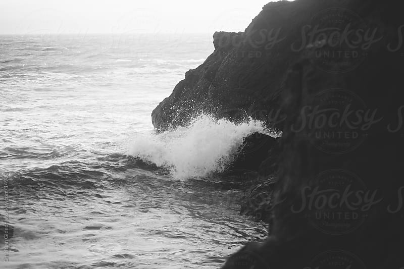 Waves crashing on rocks by Christian Gideon for Stocksy United