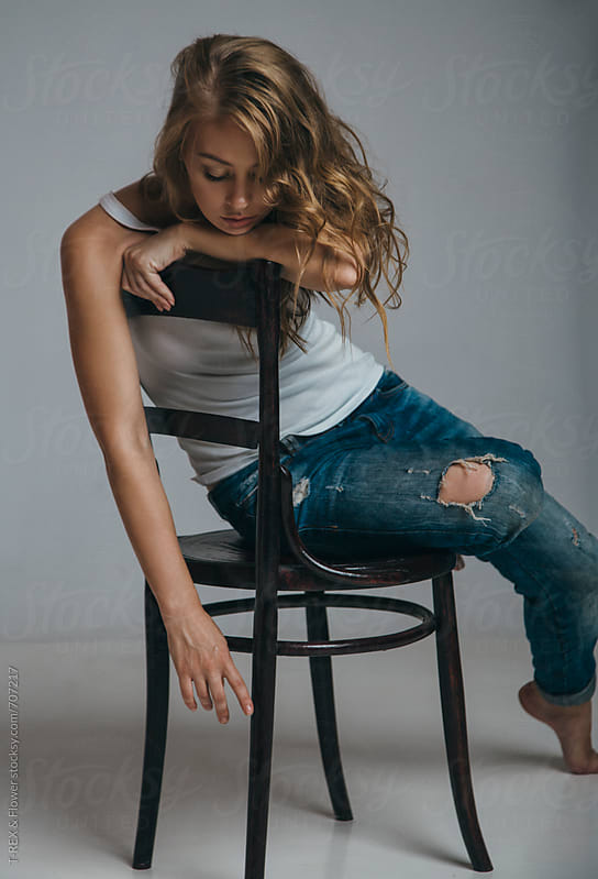 Studio shot of a girl sitting on chair by Danil Nevsky for Stocksy United