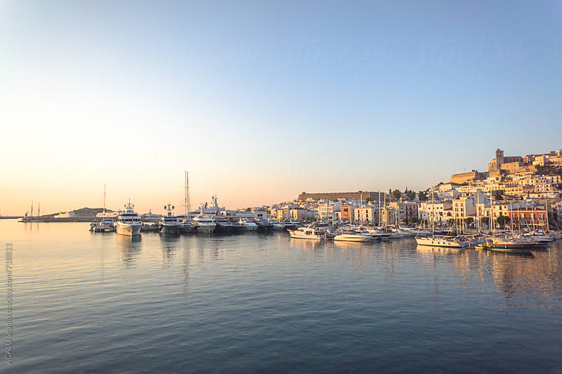 View of a beautiful sunrise in the harbor of Ibiza by ACALU Studio for Stocksy United