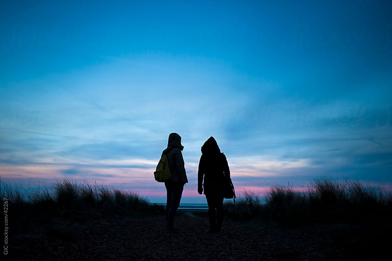 Silhouette of two backpacker women in the nature during travel by WAVE for Stocksy United