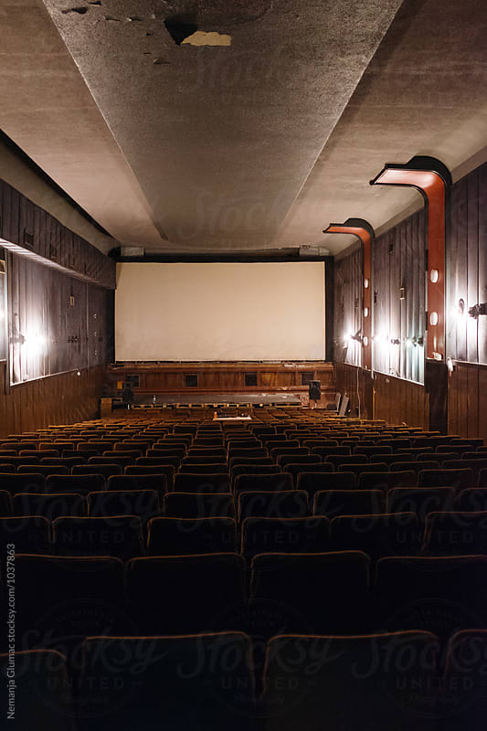 Old Abandoned Movie Theatre With Empty Screen