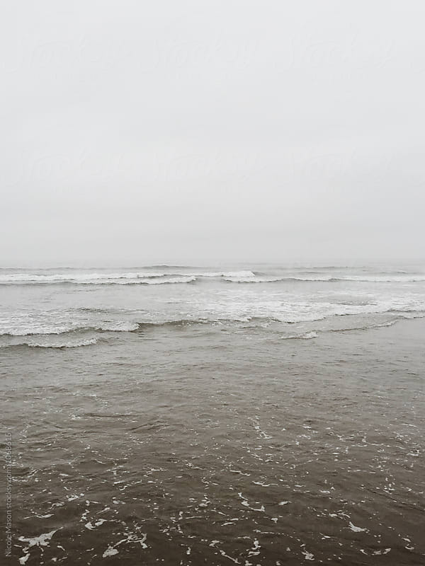 waves of the ocean on cloudy gloomy day by Nicole Mason for Stocksy United