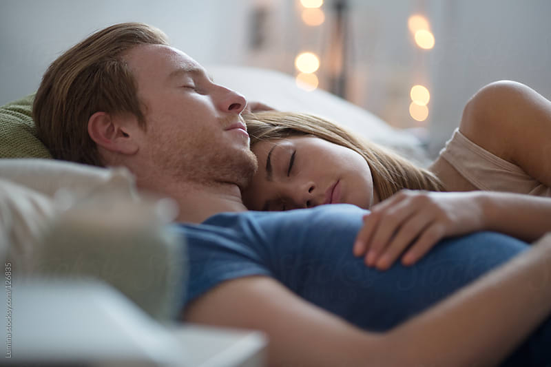 Couple Sleeping  by Lumina for Stocksy United