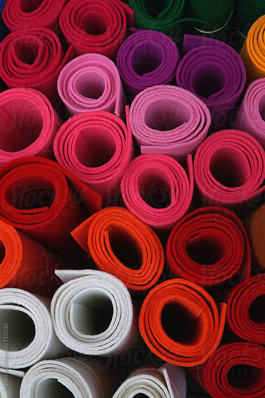 Rolls of felt for sale on a market by Marcel for Stocksy United