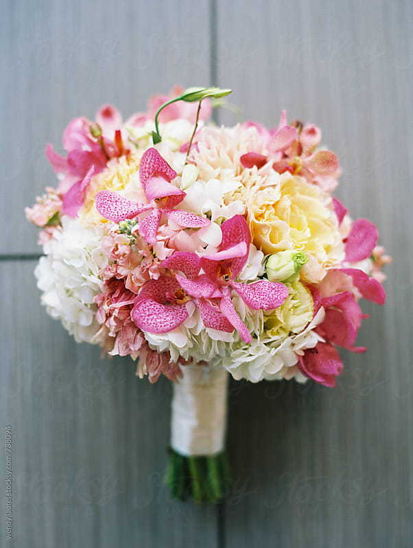 pink orange and white floral bridal bouquet by wendy laurel for Stocksy United