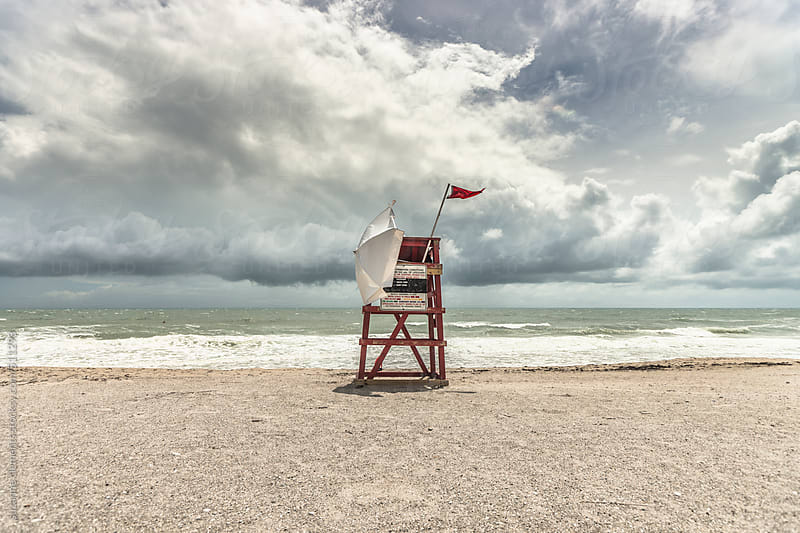 Red Flag Warning on the Beach for a Tropical Storm by suzanne clements for Stocksy United