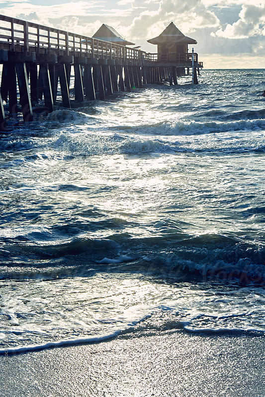Side view of an old pier at sunset by Alicja Colon for Stocksy United