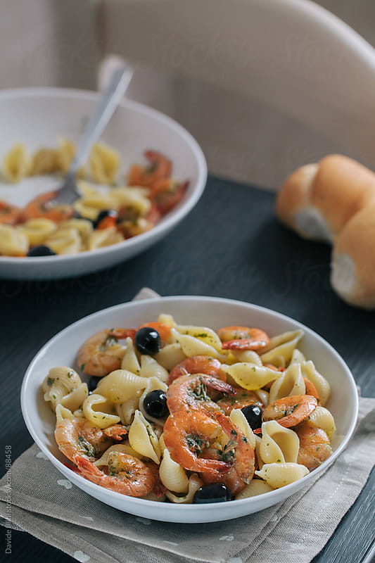 Pasta with Shrimp and Black Olives by Davide Illini for Stocksy United