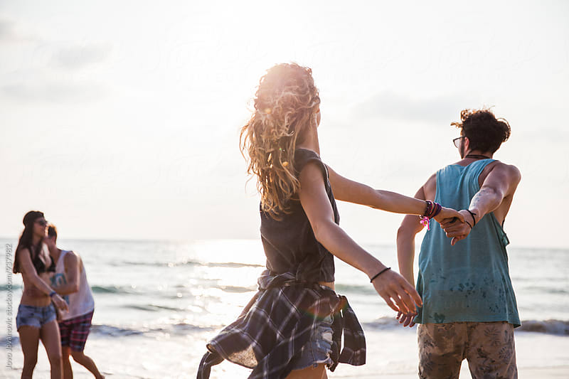 Two couples together at the beach by Jovo Jovanovic for Stocksy United