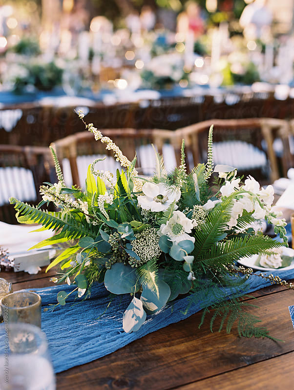 elegant natural blue runner table setting by wendy laurel for Stocksy United