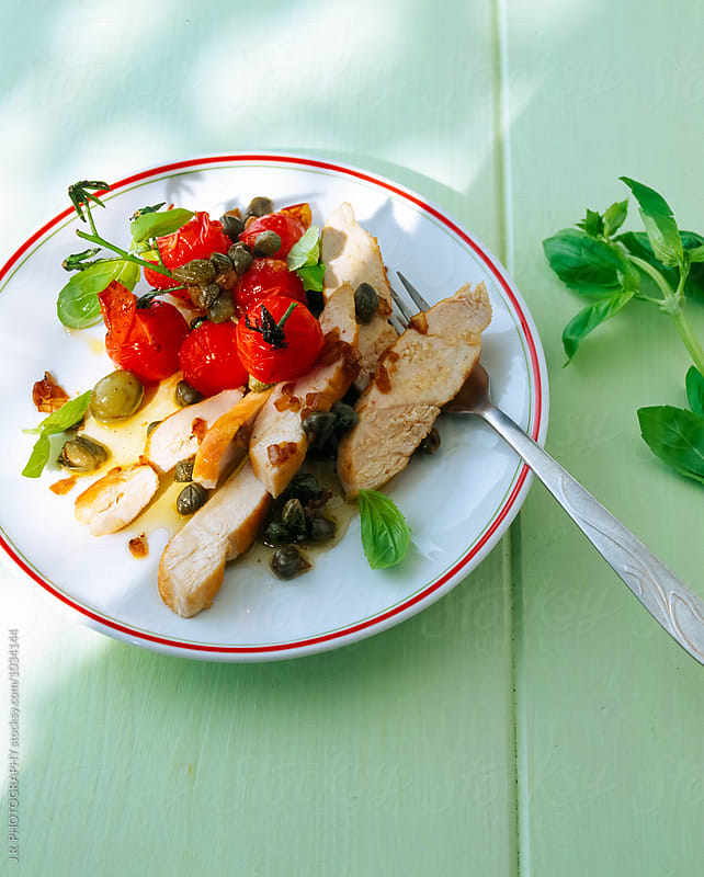 Chicken salad with capers and tomatoes by J.R. PHOTOGRAPHY for Stocksy United