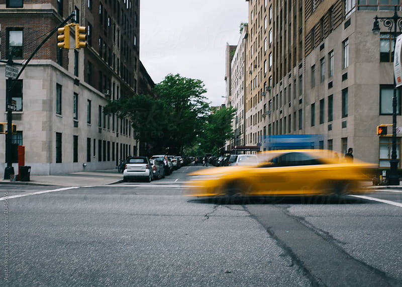 Taxi Zooming Through NYC Intersection by Austin Rogers for Stocksy United