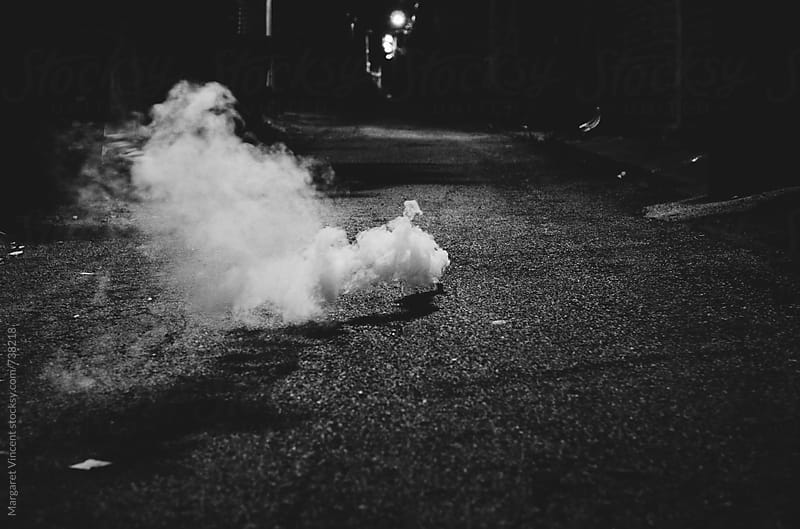smoke bomb by Margaret Vincent for Stocksy United