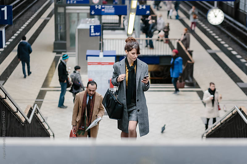 Business People At Train Station by VegterFoto for Stocksy United