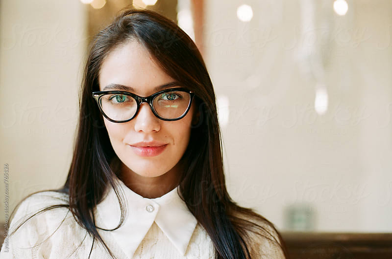 Portrait of a woman wearing glasses by Lyuba Burakova for Stocksy United