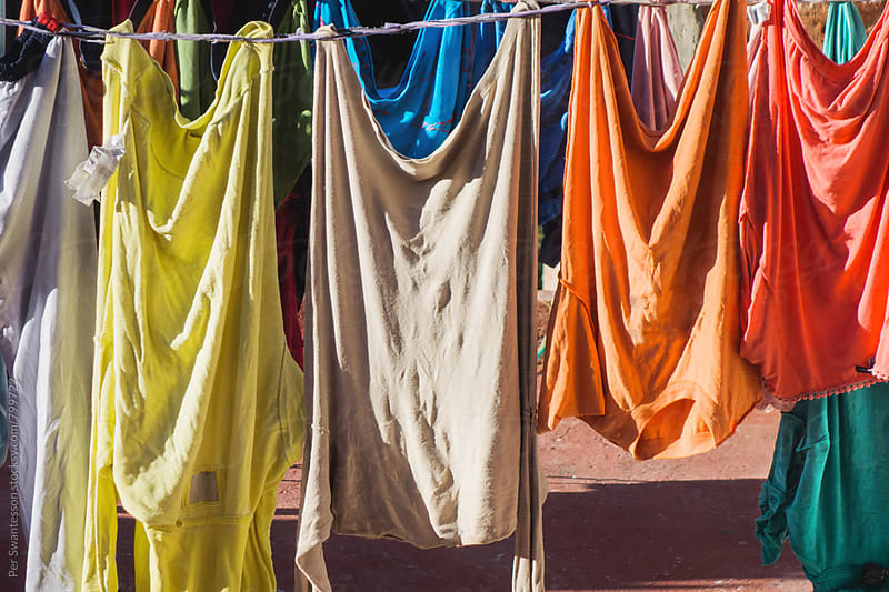 Clothesline with colorful laundry by Per Swantesson for Stocksy United