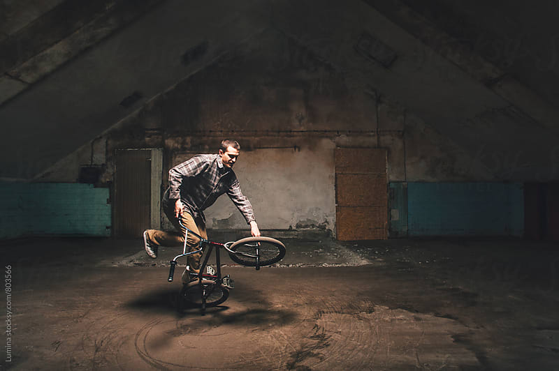 Man Doing Jumping on His BMX Bike by Lumina for Stocksy United