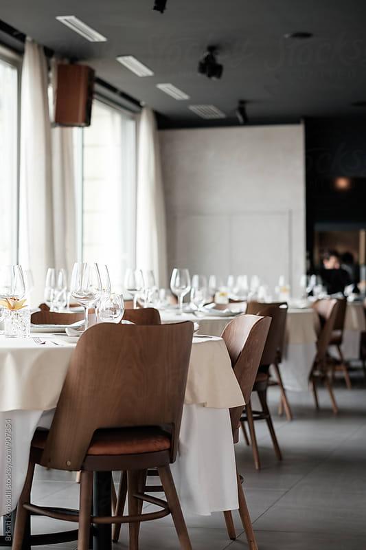Empty Tables at the Restaurant by Branislav Jovanovic for Stocksy United