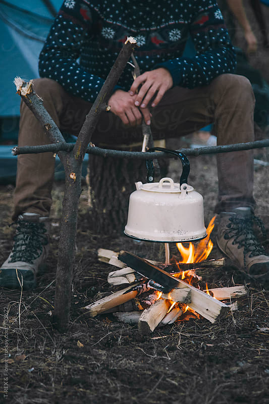Traveler warms up kettle on the bonfire by Danil Nevsky for Stocksy United