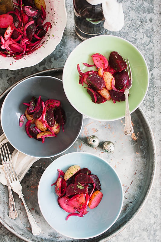 Autumn salad: Colorful beet salad served in bowls on metal background. by Darren Muir for Stocksy United