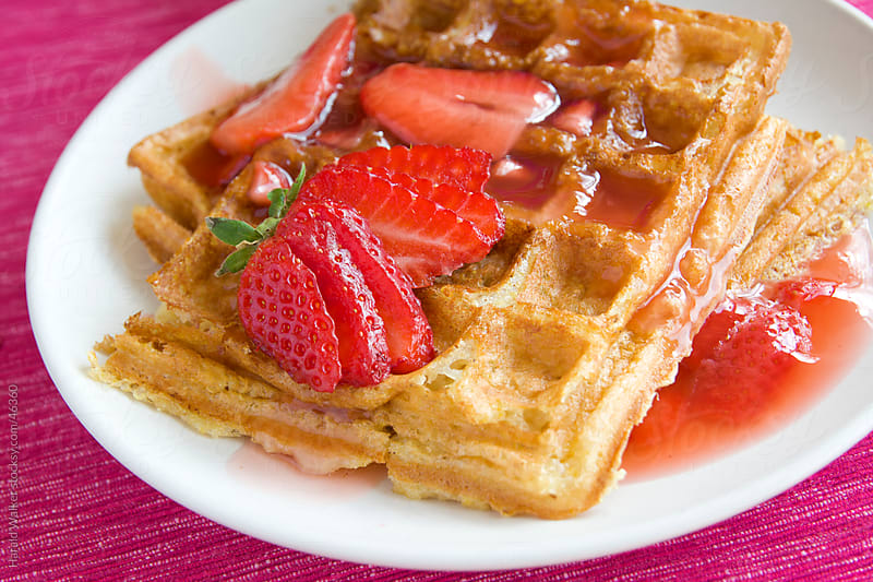 Quinoa waffles with strawberries by Harald Walker for Stocksy United