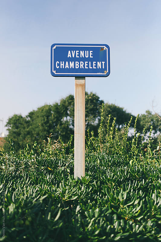 French street name on a blue road sign. by Denni Van Huis for Stocksy United