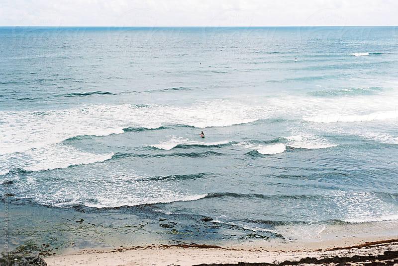 Surfer in Barbados by Sam Burton for Stocksy United