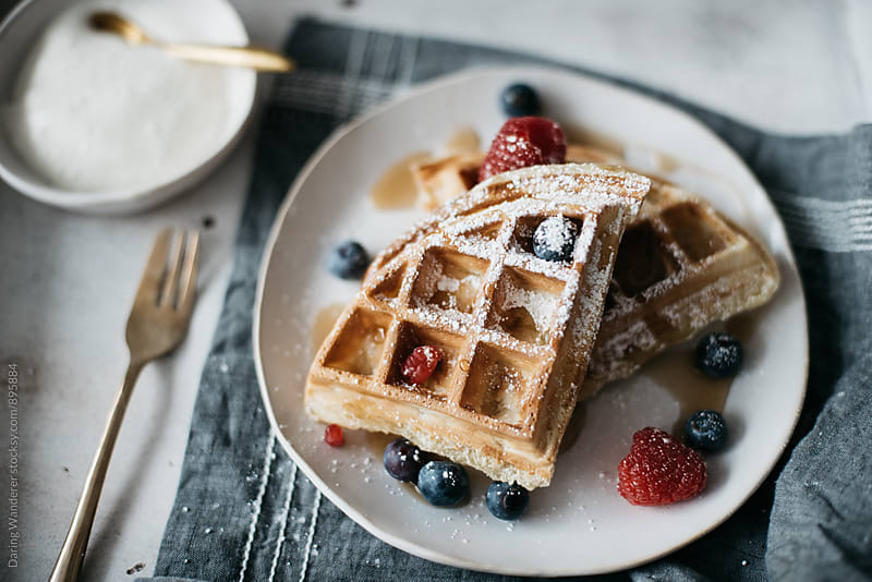 Waffles with berries on marble countertop for breakfast by Daring Wanderer for Stocksy United