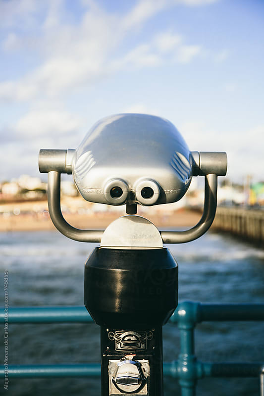 Binoculars on sunny pier by Alejandro Moreno de Carlos for Stocksy United