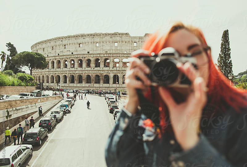 Girl photographing her friend under the Coliseum by Silvia Cipriani for Stocksy United