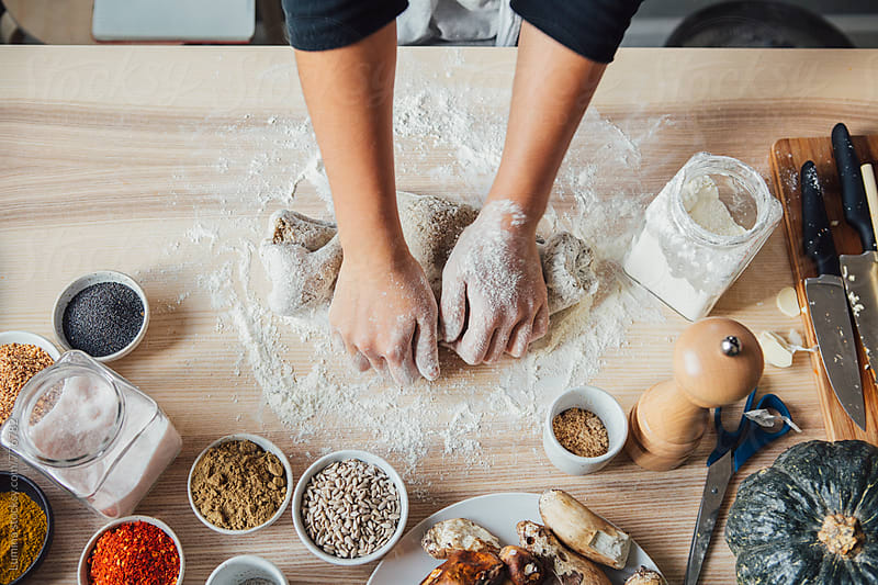 Woman Kneading Dough by Lumina for Stocksy United