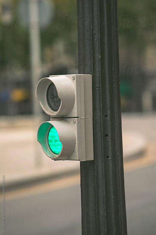 Green traffic lights on street. by BONNINSTUDIO for Stocksy United