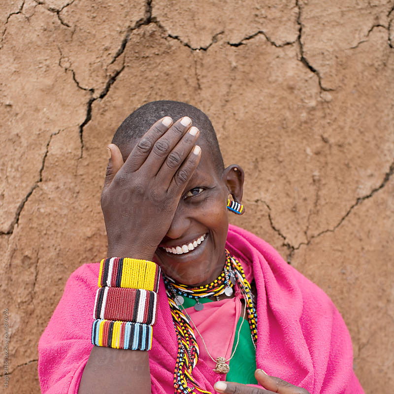 Portrait of Maasai Woman smiling into the camera. by Hugh Sitton for Stocksy United