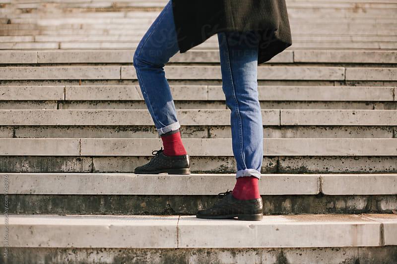 Female legs wearing jeans by Marija Kovac for Stocksy United
